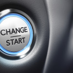 Change start button on a black dashboard background - Conceptual 3D render image with depth of field blur effect dedicated to motivation purpose.